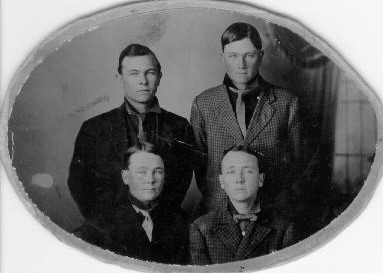 johnsonbrothers(1).jpg - The four Johnson brothers born to James W. Johnson.  William A. Johnson b. 1895, Edgar Allen Johnson b. 1879, Ira James Johnson b. 1889 and on the lower right Albert Sidney Johnson b. 1885.
