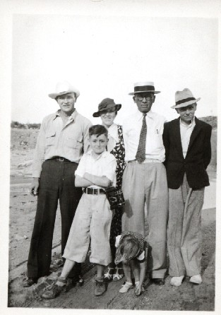 sid_and_children3.jpg - L-R Albert Sidney Johnson, Robert Dale Johnson, Carmena Forest Johnson, Albert Sidney Johnson Sr., Dan Collins Johnson. The little girl is the daughter Albert Sidney Johnson Jr., Judy Johnson. abt. I think this photo may have been in Glenrion, New Mexico at the Johnson Ranch.